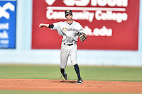 Charleston RiverDogs shortstop Tyler Wade #7 throws to first during a game against the Asheville Tourists at McCormick Field July 26, 2014 in Asheville, North Carolina. The RiverDogs defeated the Tourists 8-7. (Tony Farlow/Four Seam Images)