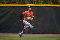 Baltimore Orioles outfielder Lamar Sparks (70) tracks a fly ball during a Minor League Spring Training game against the Tampa Bay Rays on April 23, 2021 at Charlotte Sports Park in Port Charlotte, Florida.  (Mike Janes/Four Seam Images)