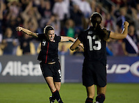 Heather O'Reilly (9) of the USWNT celebrates her goal with teammate Alex Morgan (13) during the game at WakeMed Soccer Park in Cary, NC.   The USWNT defeated Japan, 2-0.