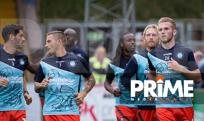Jason McCarthy of Wycombe Wanderers and the team pre match during the Carabao Cup 2nd round match between Wycombe Wanderers and Forest Green Rovers at Adams Park, High Wycombe, England on 28 August 2018. Photo by Kevin Prescod.