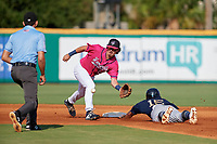 Pensacola Blue Wahoos shortstop Jordan Gore (10) fields a throw as Jahmai Jones (15) slides into second base during a Southern League game against the Mobile BayBears on July 25, 2019 at Blue Wahoos Stadium in Pensacola, Florida.  Pensacola defeated Mobile 2-1 in the first game of a doubleheader.  (Mike Janes/Four Seam Images)