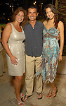 Ashley Wehrley, Philippe Schmit and Irena Hixson at the Park Place pool party Saturday night June 20, 2009.(Dave Rossman/For the Chronicle)