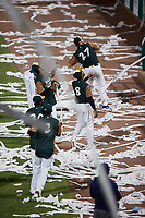 """Members of the Charleston Boiled Peanuts throw rolls of toilet paper into the stands on """"Toilet Paper Night"""" following the game against the Augusta GreenJackets at Joseph P. Riley, Jr. Park on June 26, 2021 in Charleston, South Carolina. (Brian Westerholt/Four Seam Images)"""