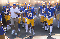 Pitt and head coach Pat Narduzzi (white shirt) takes the field. The North Carolina Wolfpack defeated the Pitt Panthers 35-17 at Heinz Field, Pittsburgh, PA on October 14, 2017.