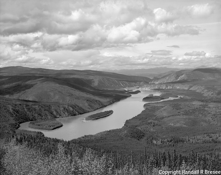 """""""Yukon River Near Dawson"""" <br /> Yukon Territory, Canada <br /> <br /> Dawson City sits on the bank of the mighty Yukon River in Canada's Yukon Territory. Dawson is a good place to visit because the city itself and its immediate vicinity offer so many sights to see. A few minutes from Dawson is a terrific drive that takes you high above town to the """"Dome."""" This photograph of the Yukon River below was recorded from the Dome."""