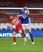 16th March 2021; Cardiff City Stadium, Cardiff, Glamorgan, Wales; English Football League Championship Football, Cardiff City versus Stoke City; Sean Morrison of Cardiff City heads the ball whilst challenging Tommy Smith of Stoke City