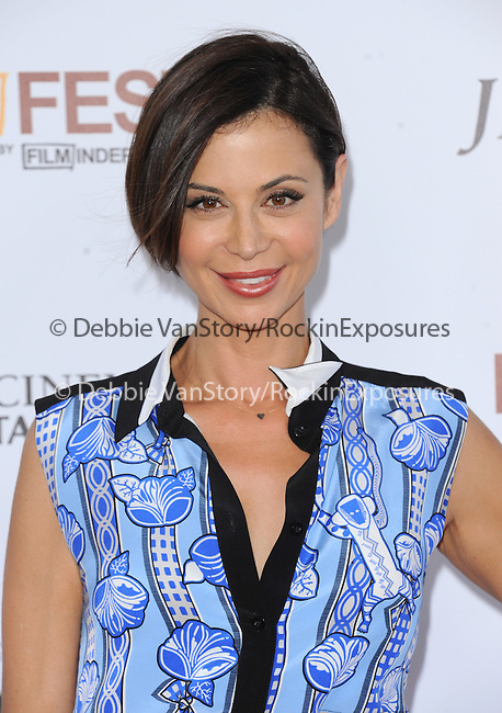 """Catherine Bell attends The Los Angeles Film Festival 2014 Closing Night Premiere of Warner bros. Pictures """"Jersey Boys"""" held at The Regal Cinemas L.A. Live in Los Angeles, California on June 19,2014                                                                               © 2014 Hollywood Press Agency"""