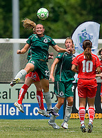 St. Louis Athletica forward Christie Welsh (23) goes up for a ball against the Washington Freedom during a WPS match at Anheuser-Busch Soccer Park, in Fenton, MO, June 20 2009. Washington  won the match 1-0.