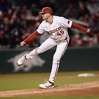Arkansas reliever Kevin Kopps delivers to the plate Thursday, April 1, 2021, during the ninth inning of Razorbacks' 2-1 loss to Auburn at Baum-Walker Stadium in Fayetteville. Visit nwaonline.com/210402Daily/ for today's photo gallery. <br /> (NWA Democrat-Gazette/Andy Shupe)