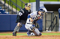 Georgia Southern Eagles catcher Chase Griffin (23) tries to block a pitch in the dirt as home plate umpire Tom Haight looks on during the game against the UNCG Spartans at UNCG Baseball Stadium on March 29, 2013 in Greensboro, North Carolina.  The Spartans defeated the Eagles 5-4.  (Brian Westerholt/Four Seam Images)