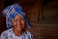 An old women at the hidden Thameewhetumin cave temple Bagan, Myanmar, Burma.
