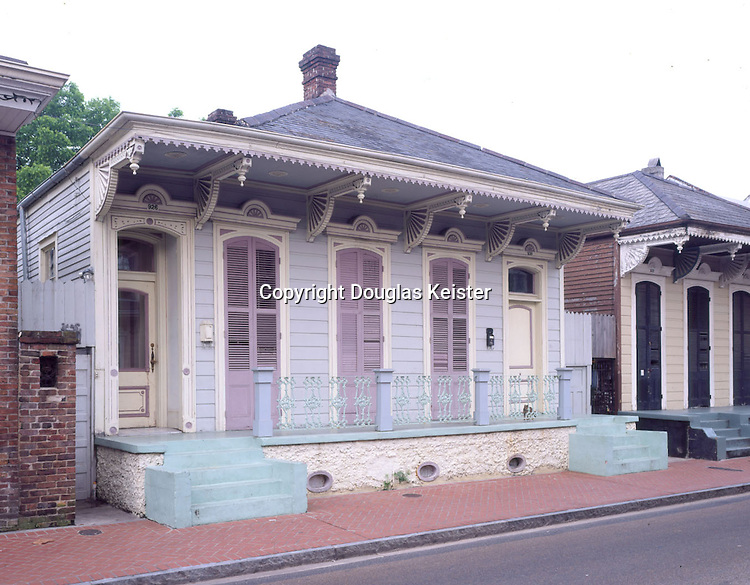 New Orleans, Louisiana.  1855-1860.  Built in the French Quarter or Vieux Carre of New Orleans, this shotgun cottage is a classic example of the style.  Ornate spindles and brackets enliven the straightforward architecture.