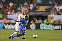 PHILADELPHIA, PENNSYLVANIA - JUNE 30: Michael Bradley #4, Elson Hooi #18 during the 2019 CONCACAF Gold Cup quarterfinal match between the United States and Curacao at Lincoln Financial Field on June 30, 2019 in Philadelphia, Pennsylvania.