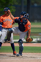 Houston Astros catcher Oscar Campos (62) throws down to second base as Seth Beer (3) looks on during a Minor League Spring Training Intrasquad game on March 28, 2019 at the FITTEAM Ballpark of the Palm Beaches in West Palm Beach, Florida.  (Mike Janes/Four Seam Images)