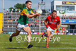Brian Ó Beaglaoich, Kerry, in action against Sean Powter, Cork, during the Munster GAA Football Senior Championship Final match between Kerry and Cork at Fitzgerald Stadium in Killarney on Sunday.