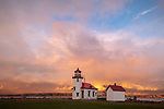 Vashon-Maury Island, WA: Point Robinson Lighthouse with colorful clearing storm clouds at sunset