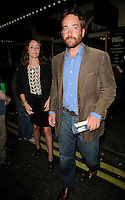 """KEELEY HAWES & MATTHEW MacFADYEN.The """"Ghost Stories"""" VIP evening, Duke of York's Theatre, London, England..July 14th, 2010.full length black skirt jacket white gold brown pattern top ankle boots jacket beard facial hair jeans denim married husband wife cords corduroy .CAP/CAN.©Can Nguyen/Capital Pictures."""