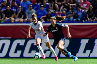 HARRISON, NJ - SEPTEMBER 29: Carson Pickett #16 of the Orlando Pride and Paige Monaghan #4 of Sky Blue FC during a game between Orlando Pride and Sky Blue FC at Red Bull Arena on September 29, 2019 in Harrison, New Jersey.