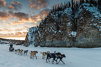 Martin Buser runs down the Yukon River at sunsrise after leaving the Ruby Checkpoint on Saturday March 12th during the 2016 Iditarod.  Alaska    <br /> <br /> Photo by Jeff Schultz (C) 2016  ALL RIGHTS RESERVED