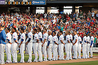 Round Rock Express players during the national anthem before the MLB exhibition baseball game against the Texas Rangers on April 2, 2012 at the Dell Diamond in Round Rock, Texas. The Rangers out-slugged the Express 10-8. (Andrew Woolley / Four Seam Images).