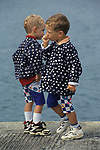 Brittany France 1990s Two young boys, twins, thumb sucking on holiday. 1990.