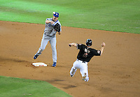 Jul 19, 2008; Phoenix, AZ, USA; Los Angeles Dodgers second baseman Jeff Kent throws to first base to complete the double play after forcing out Arizona Diamondbacks base runner Stephen Drew in the second inning at Chase Field. Mandatory Credit: Mark J. Rebilas-
