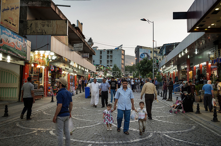 09/06/15. Shaqlawa, Iraq. -- The main street of Shaqlawa's centre, with shops, restaurants and cafes. Shaqlawa is a famous touristic destination attracting tourists from the whole of Iraq before the beginning of the crisis. Today it is home to more than 40.000 IDPs.
