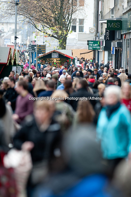 Saturday 14 December 2013<br /> Pictured: Crowds of Shoppers along Swansea's busy Oxford Street in the City Centrre<br /> Re: Towns and City's are busy with shoppers  across the UK as Christmas  is only 10 days away.