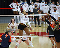 Arkansas Senior Ellease Crumpton (6) spikes the ball on Auburn on Sunday, Oct. 10, 2021, during play at Barnhill Arena, Fayetteville. Visit nwaonline.com/211011Daily/ for today's photo gallery.<br /> (Special to the NWA Democrat-Gazette/David Beach)