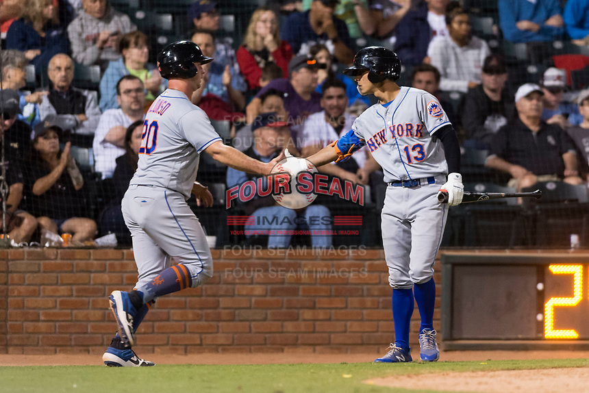 AFL East first baseman Peter Alonso (20) is congratulated by Andres Gimenez (13), both of the Scottsdale Scorpions and New York Mets organization, after scoring a run during the Arizona Fall League Fall Stars game at Surprise Stadium on November 3, 2018 in Surprise, Arizona. The AFL West defeated the AFL East 7-6 . (Zachary Lucy/Four Seam Images)