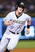 Josh Richmond (32) of the Charlotte Knights hustles towards third base against the Gwinnett Braves at BB&T Ballpark on August 19, 2014 in Charlotte, North Carolina.  The Braves defeated the Knights 10-5.   (Brian Westerholt/Four Seam Images)