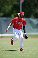 GCL Phillies West outfielder Jose Pujols (23) fields a ball during a Gulf Coast League game against the GCL Yankees East on August 3, 2019 at the Carpenter Complex in Clearwater, Florida.  The GCL Yankees East defeated the GCL Phillies West 4-0, the second game of a doubleheader.  (Mike Janes/Four Seam Images)