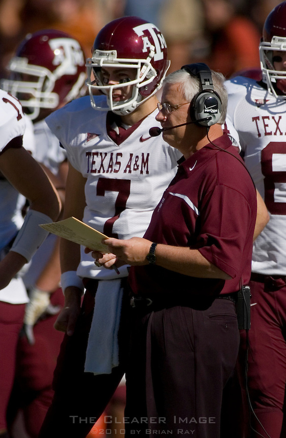 24 November 2006: Texas A&M head coach Dennis Franchione talks to his quarterback, Stephen McGee (#7) on the sidelines during the Aggies 12-7 victory over the University of Texas Longhorns at Darrell K Royal Memorial Field in Austin, TX.