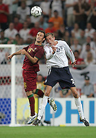 Portuguese defender (16) Ricardo Carvalho goes up for a header against English forward (21) Peter Crouch.  Portugal defeated England on penalty kicks after playing to a 0-0 tie in regulation in their FIFA World Cup quarterfinal match at FIFA World Cup Stadium in Gelsenkirchen, Germany, July 1, 2006.