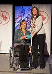 Calgary, AB - June 5 2014 - Sonja Gaudet receives her Paralympic ring from Erin Kelly, of Suncor/Petro-Canada, during the Celebration of Excellence Paralympic Ring Reception in Calgary. (Photo: Matthew Murnaghan/Canadian Paralympic Committee)
