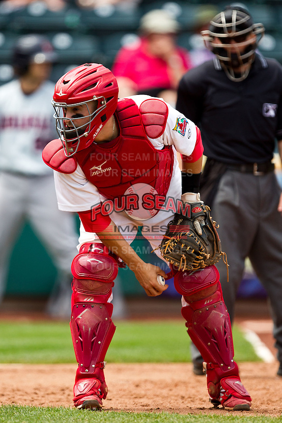 Nick Derba (18) of the Springfield Cardinals picks up a foul ball during a game against the Arkansas Travelers at Hammons Field on May 8, 2012 in Springfield, Missouri. (David Welker/ Four Seam Images)
