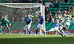 Celtic v St Johnstone...29.08.15  SPFL   Celtic Park<br /> Leigh Griffiths shot deflects off David Wotherspoon to make it 1-1<br /> Picture by Graeme Hart.<br /> Copyright Perthshire Picture Agency<br /> Tel: 01738 623350  Mobile: 07990 594431