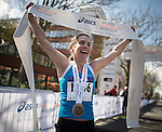 © Joel Goodman - 07973 332324 . 10/04/2016 . Manchester , UK . KELLY CRICKMORE (from Stockport ), winner of the women's race at the 40th Greater Manchester Marathon . Photo credit : Joel Goodman