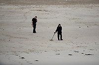 Pictured: A general view of people metal detecting at Porthcawl in Bridgend, Wales, UK. Monday 17 September 2018<br /> Re: Storm Helene is set to hit parts of Wales according to the Met Office.<br /> There is a yellow warning from 9pm and is expected to last until 6pm on Tuesday.<br /> Winds are likely to reach 40mph to 50mph with top gusts of up to 60mph.