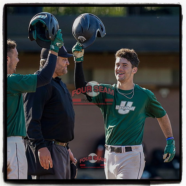 Easton Cullison (0) of the USC Upstate Spartans Green team, right, is greeted after hitting a two-run home run in the Green and Black Fall World Series Game 3 on Sunday, November 1, 2020, at Cleveland S. Harley Park in Spartanburg, South Carolina. Green won, 3-2. (Tom Priddy/Four Seam Images) #NCAA