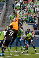 Kasey Keller (c) of the Seattle Sounders goes up high to punch the ball away from Chris Pontius (13) of DC United in the match played on June 17, 2009 at Quest Field in Seattle, WA. The Sounders and United played to a 3-3 draw.