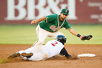 Greensboro Grasshoppers shortstop Anthony Gomez (2) waits to apply the tag as Tim Anderson (2) of the Kannapolis Intimidators is caught trying to steal second base at CMC-Northeast Stadium on July 12, 2013 in Kannapolis, North Carolina.  The Grasshoppers defeated the Intimidators 2-1.   (Brian Westerholt/Four Seam Images)