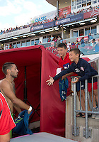 August 10, 2013: Seattle Sounders FC forward Clint Dempsey #2 gives his warm up jersey to some small fans during an MLS regular season game between the Seattle Sounders and Toronto FC at BMO Field in Toronto, Ontario Canada.<br /> Seattle Sounders FC won 2-1.