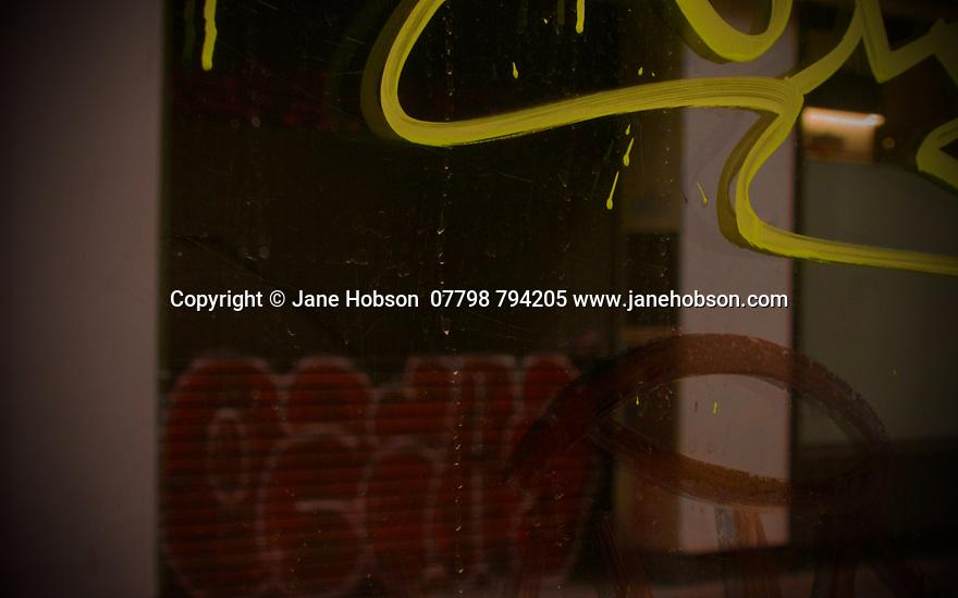 London, UK. 02.02.2020. Reflections and graffiti, Soho, London, UK. Photograph © Jane Hobson.