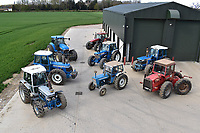 BNPS.co.uk (01202) 558833. <br /> Pic: Cheffins/BNPS<br /> <br /> Pictured: A farming family is today celebrating after their incredible collection of almost 100 vintage tractors sold for a staggering £1million.<br /> <br /> Father and son duo Ian and Martin Liddell began hoarding the agricultural vehicles at their arable farm in the 1980s.<br /> <br /> Their fleet of tractors was so large that they had to be stored in three barns.<br /> <br /> The prized collection sparked a worldwide bidding war when it was sold with auctioneers Cheffins, of Cambridge, after the family decided to part with the tractors to free up space on their Essex farm to pursue other projects.