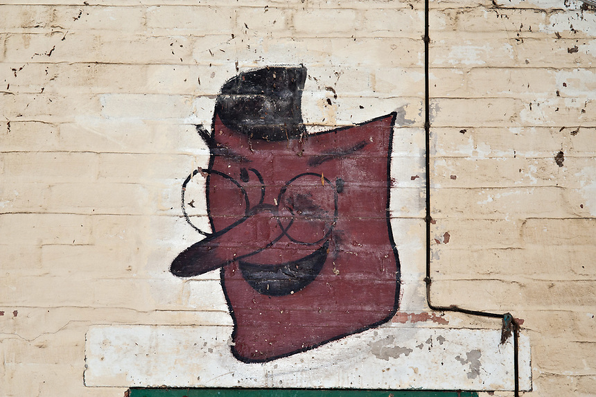 ©Si Barber 07739 472 922. <br /> A mural depicting  a theatrical mask in derelict buildings at former US Air Force base RAF Flixton, Suffolk.<br /> <br /> USAGE TERMS: ONE USE IN PRINT AND ONLINE. NO SYNDICATION, RETENTION, OR THIRD PARTY SALES. MINIMUM FEES APPLY