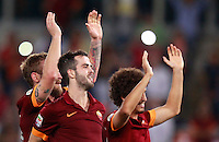 Calcio, Serie A: Roma vs ChievoVerona. Roma, stadio Olimpico, 18 ottobre 2014.<br /> From left, Roma's Daniele De Rossi, Miralem Pjanic and Salih Ucan greet fans at the end of the Italian Serie A football match between Roma and ChievoVerona at Rome's Olympic stadium, 18 October 2014. Roma won 3-0.<br /> UPDATE IMAGES PRESS/Isabella Bonotto