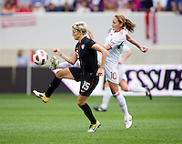 Megan Rapinoe (15) of the USWNT fights for the ball with Dinora Garza (10) of Mexico during the game at Red Bull Arena in Harrison, NJ.  The USWNT defeated Mexico, 1-0.
