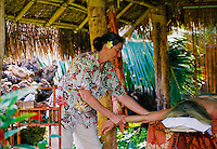 Woman recieving Hawaiian Lomi Lomi massage at the Mauna Lani spa