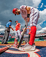 20 May 2018: Washington Nationals outfielder Bryce Harper tends to his bat on the on-deck circle during a game against the Los Angeles Dodgers at Nationals Park in Washington, DC. The Dodgers defeated the Nationals 7-2, sweeping their 3-game series. Mandatory Credit: Ed Wolfstein Photo *** RAW (NEF) Image File Available ***